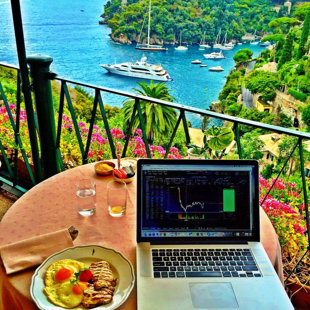laptop with foods and a view